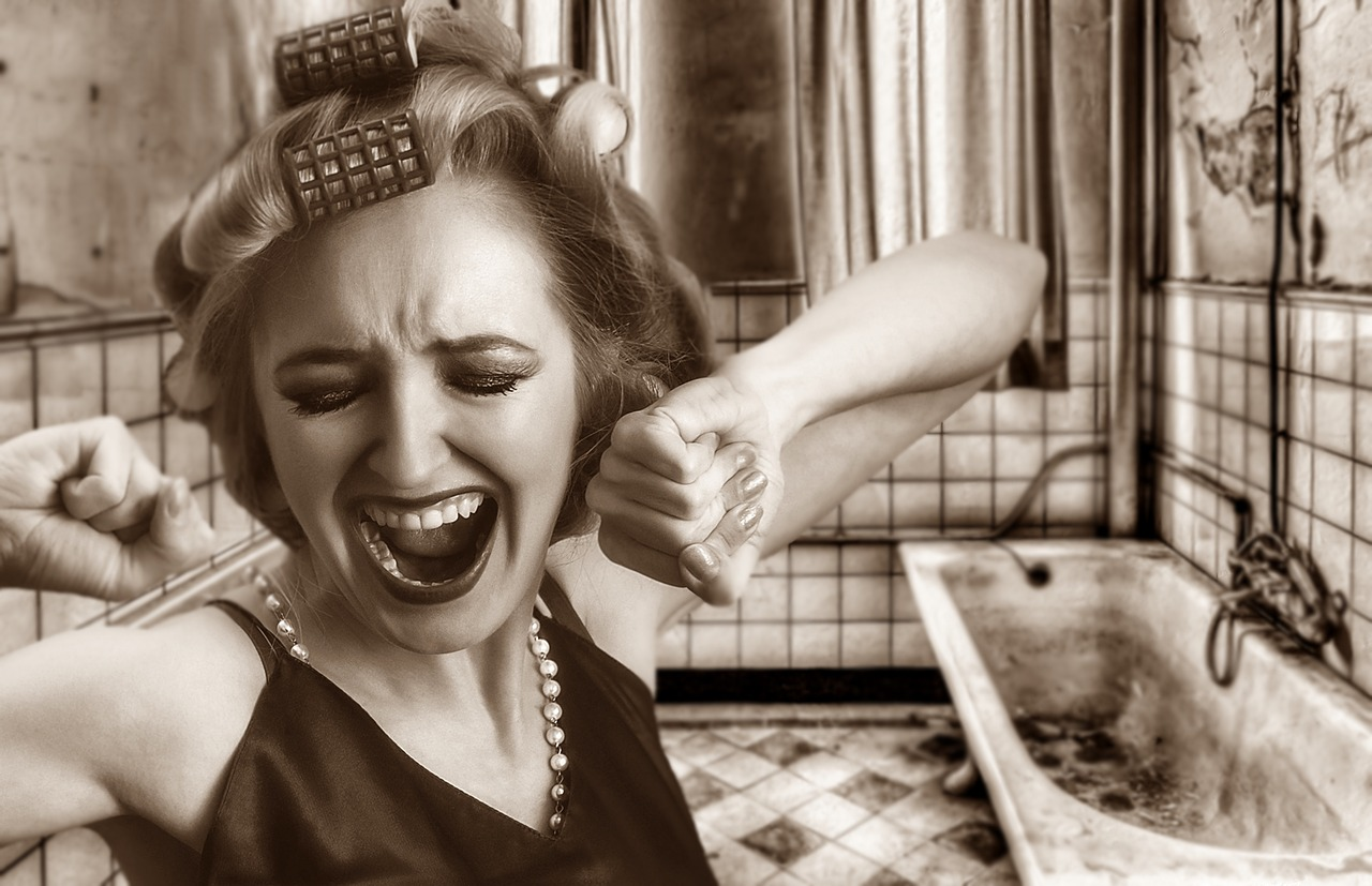 A woman screaming in her bathroom